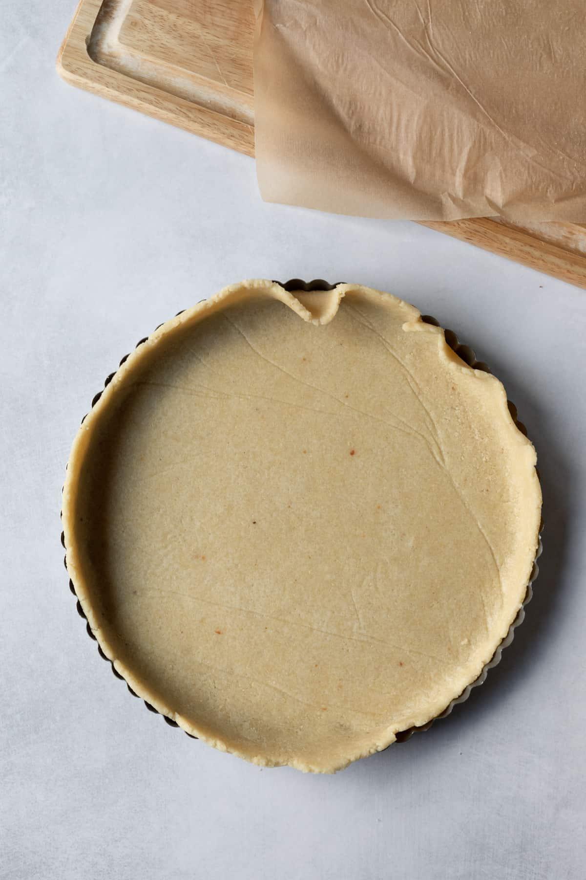 dough flipped into pan ready to trim edges