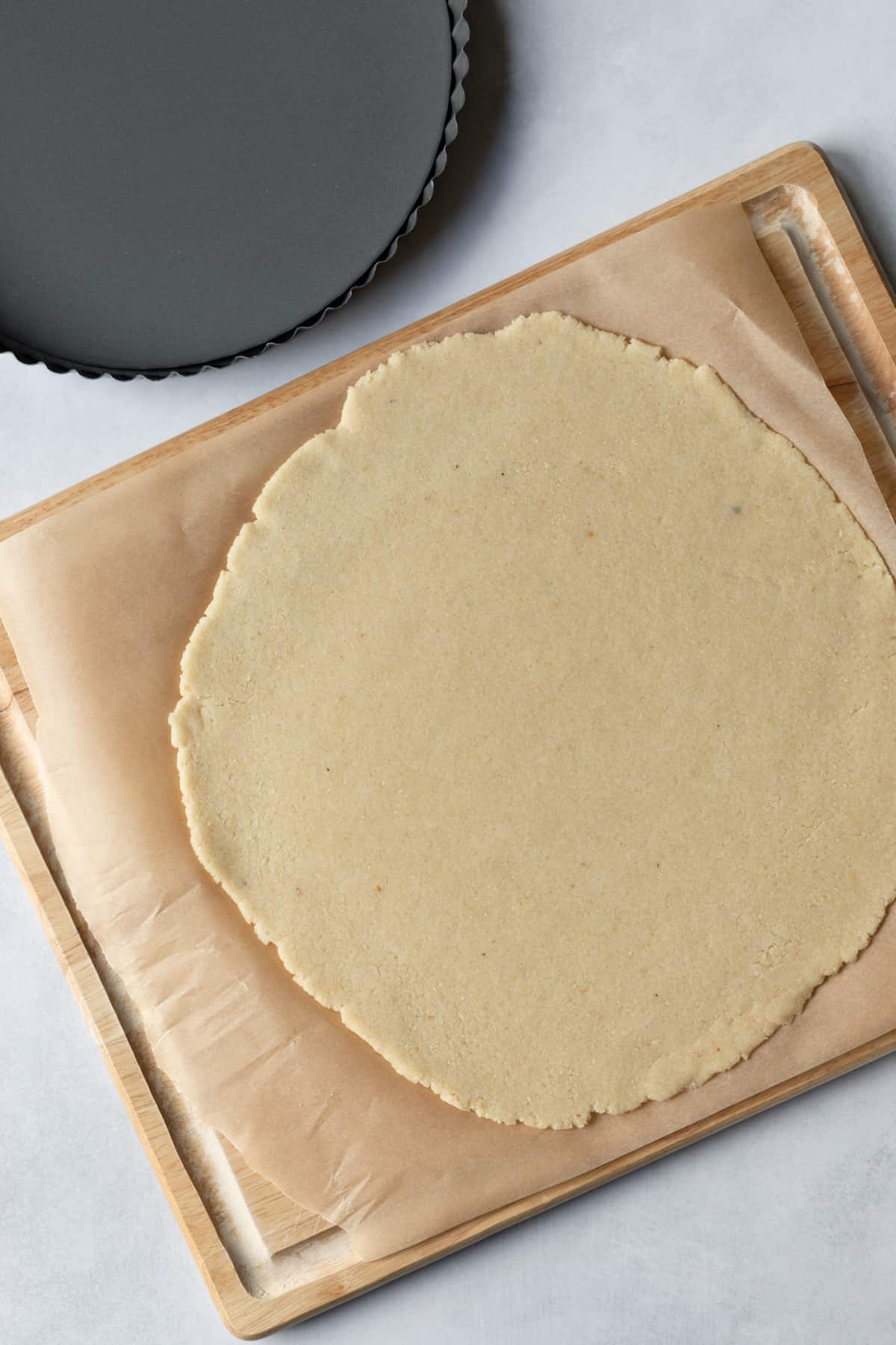 rolled out dough on parchment