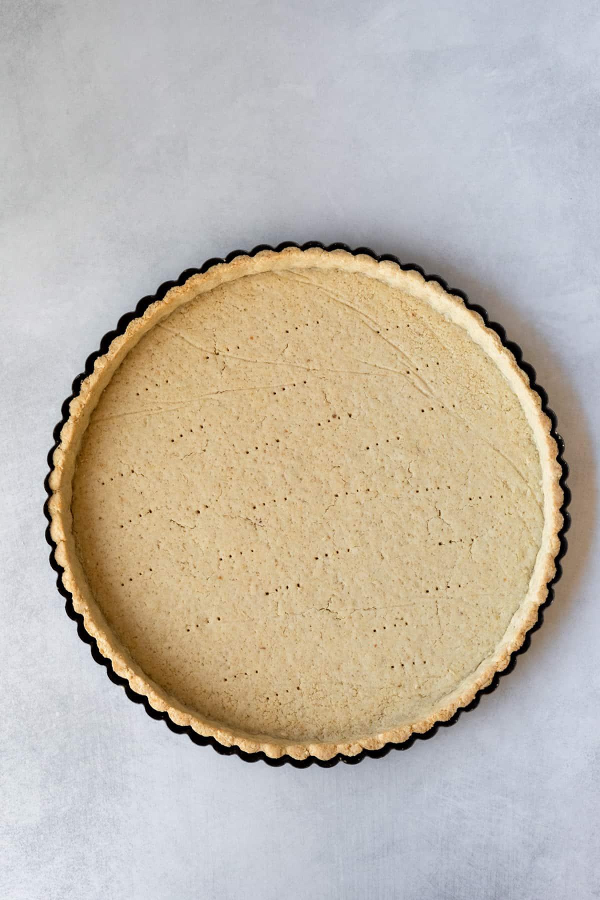 baked crust in a tart pan