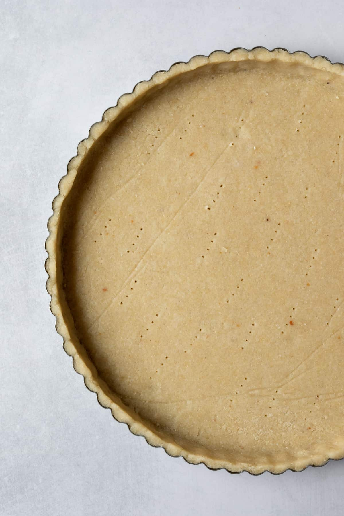 unbaked crust pressed into tart pan with fluted edges