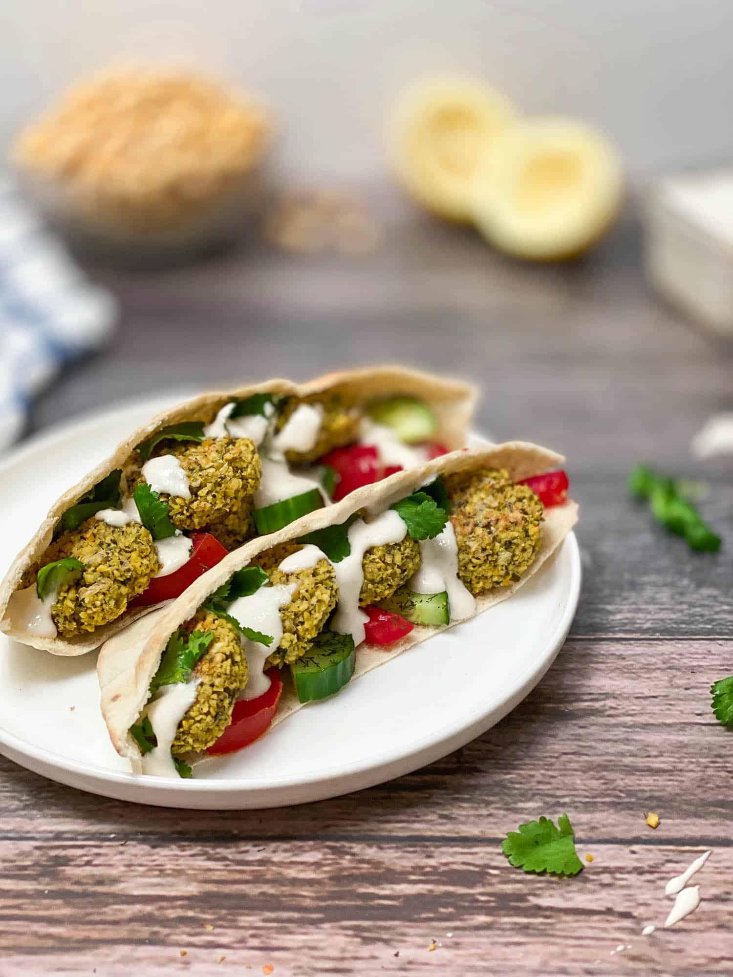 pita stuffed with falafel and creamy sauce