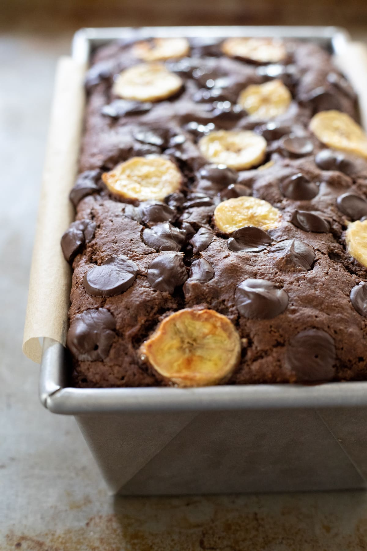 chocolate banana bread in a metal loaf pan