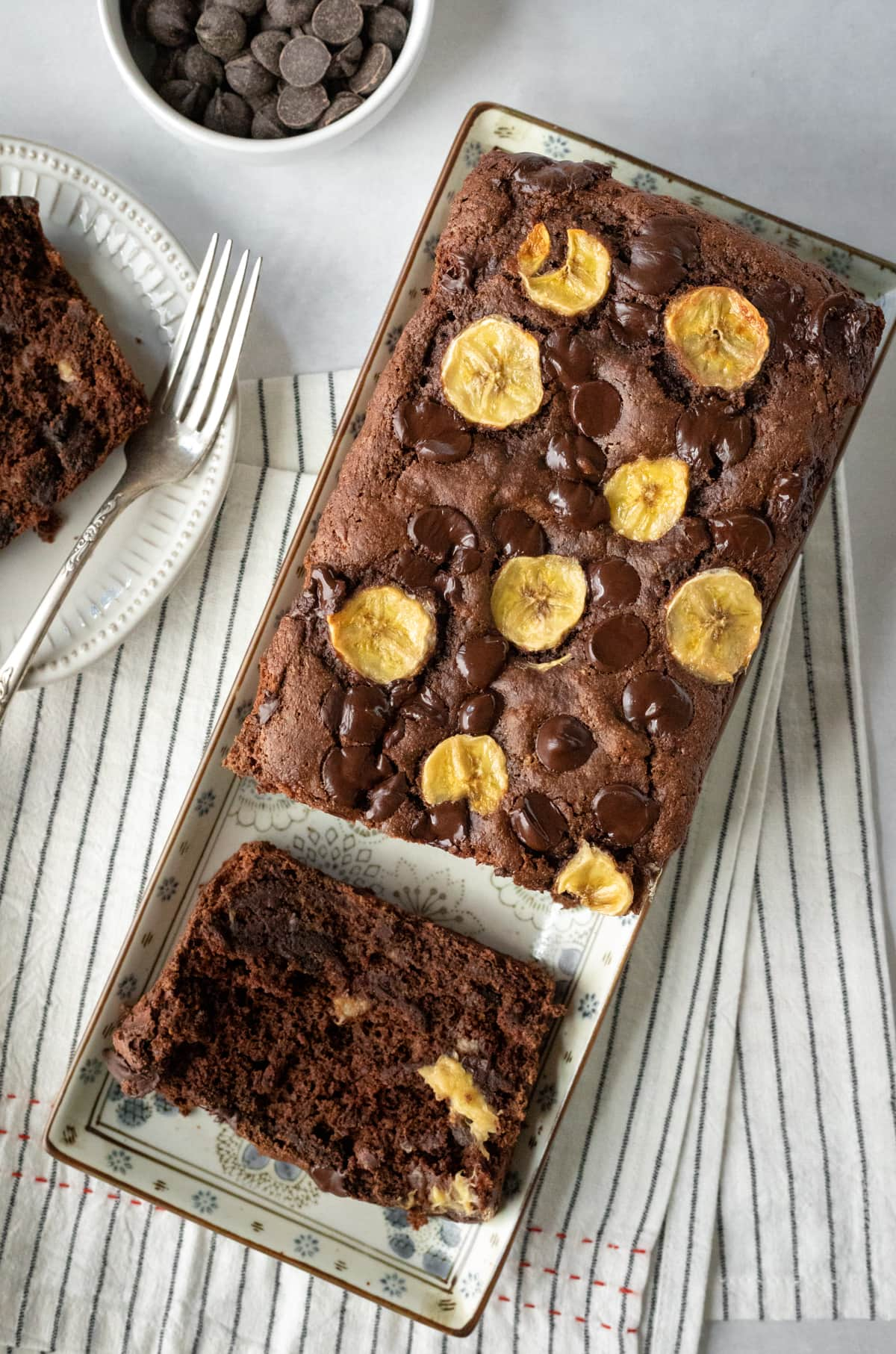 dark chocolate loaf with banana slices baked into the top