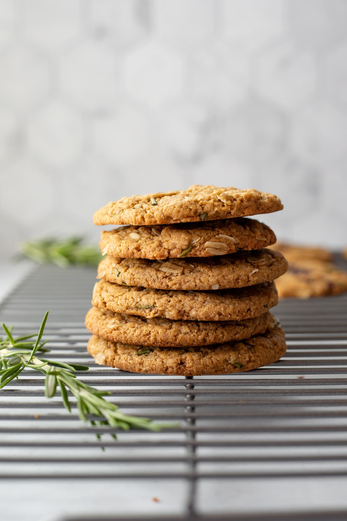 a stack of oatmeal rosemary cookies