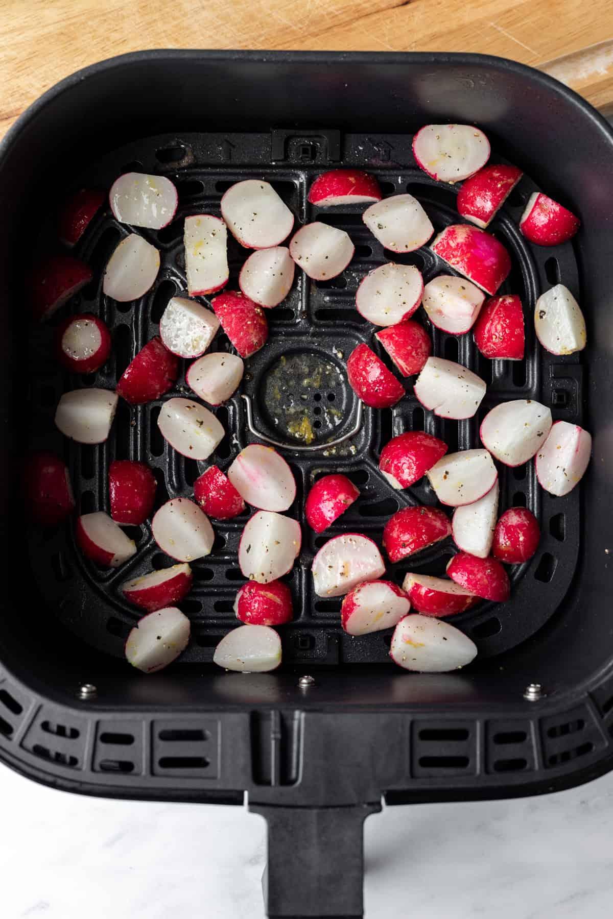 trimmed radishes inside air fryer basket