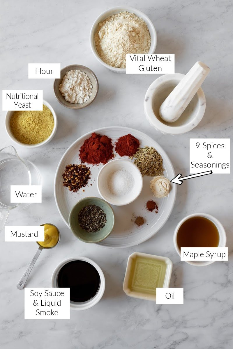 labeled photo of the ingredients and spices needed to make vegan pepperoni at home.