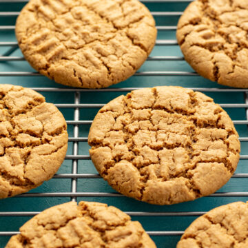 cookies on cooling rack against aqua colored background