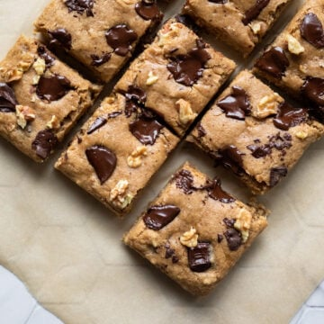 overhead view of cut blondies on parchment paper