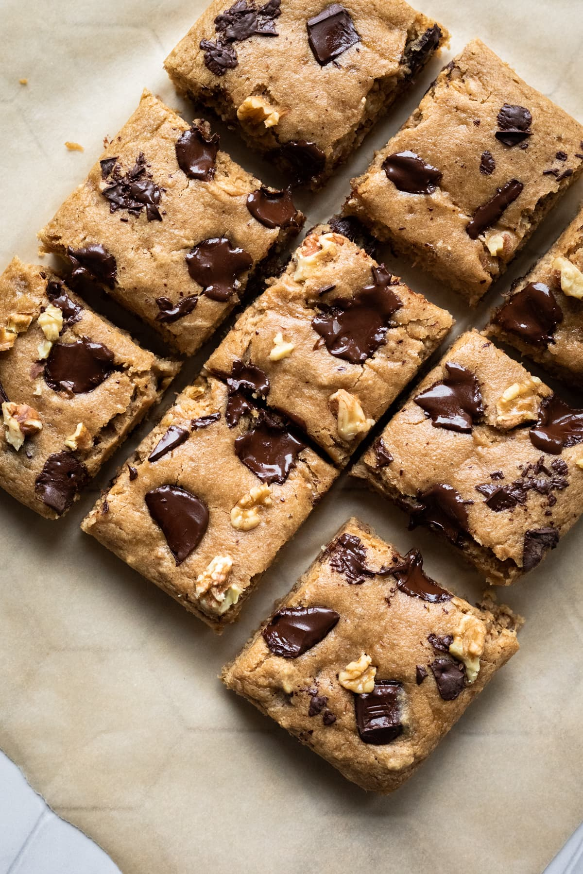 sliced blondies with gooey melted chocolate chunks on top