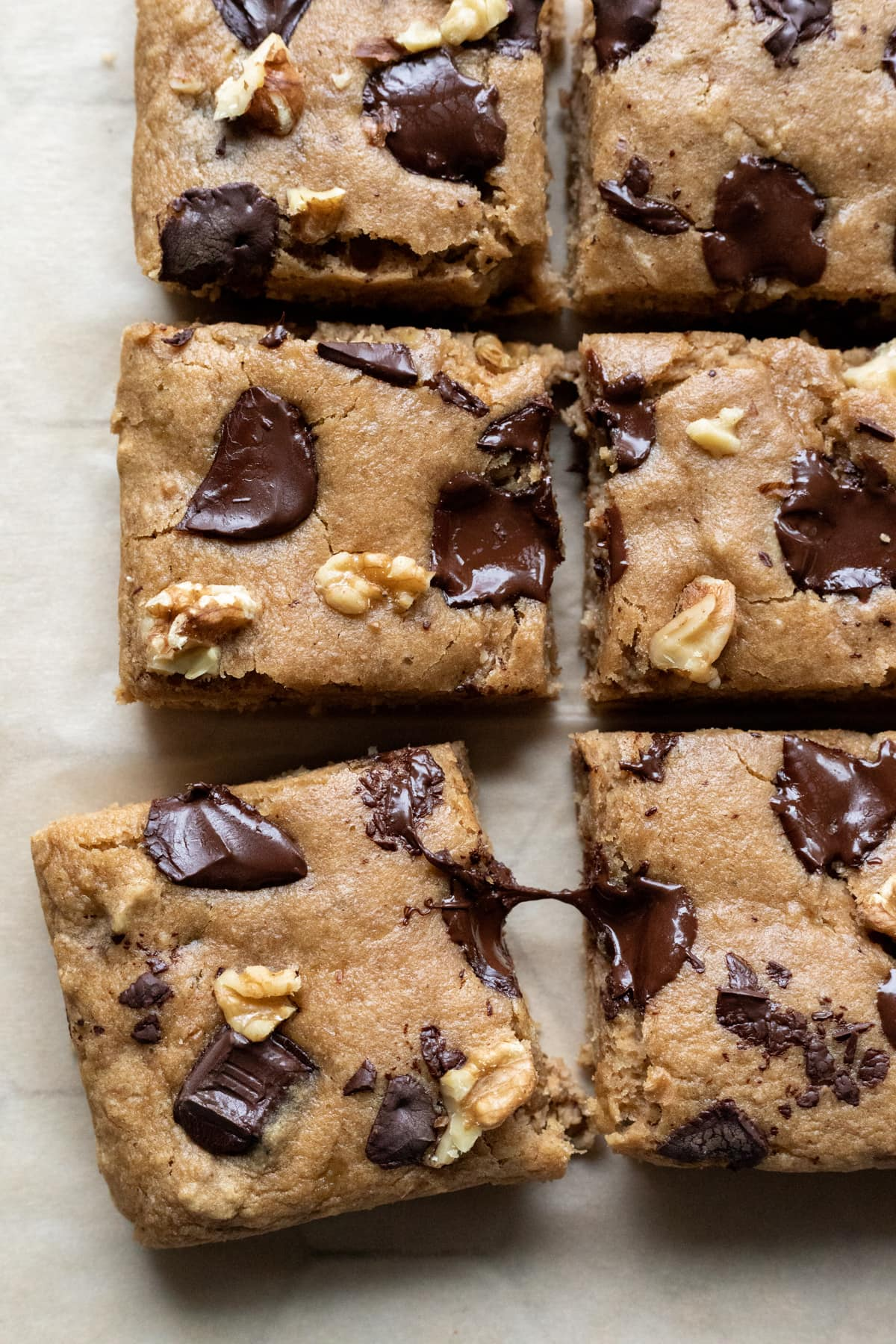 banana blondies with melty warm chunks of chocolate on top