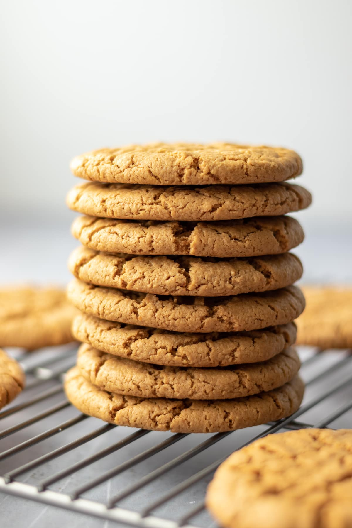 close up of a tall stack of golden sunflower butter cookies