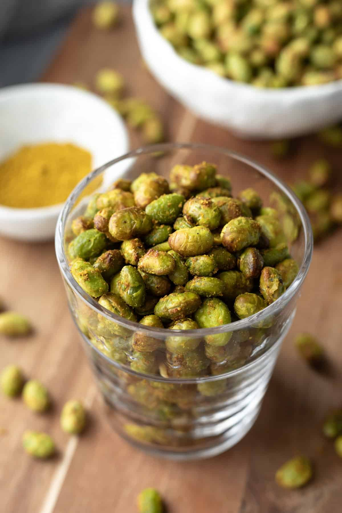 close up of cooked edamame in a glass.