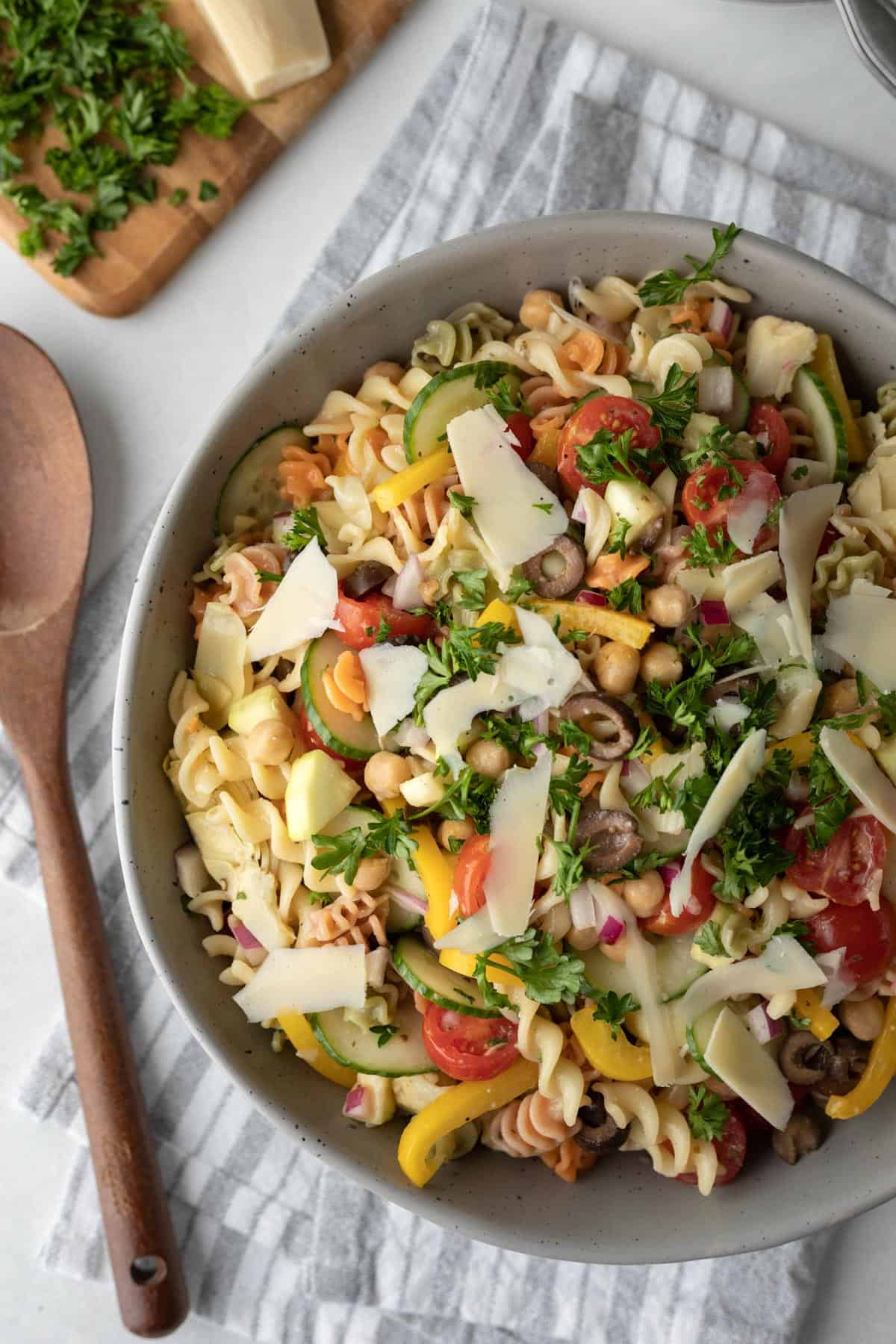large serving bowl full of oil-free pasta salad dressed with this no oil aquafaba vinaigrette.