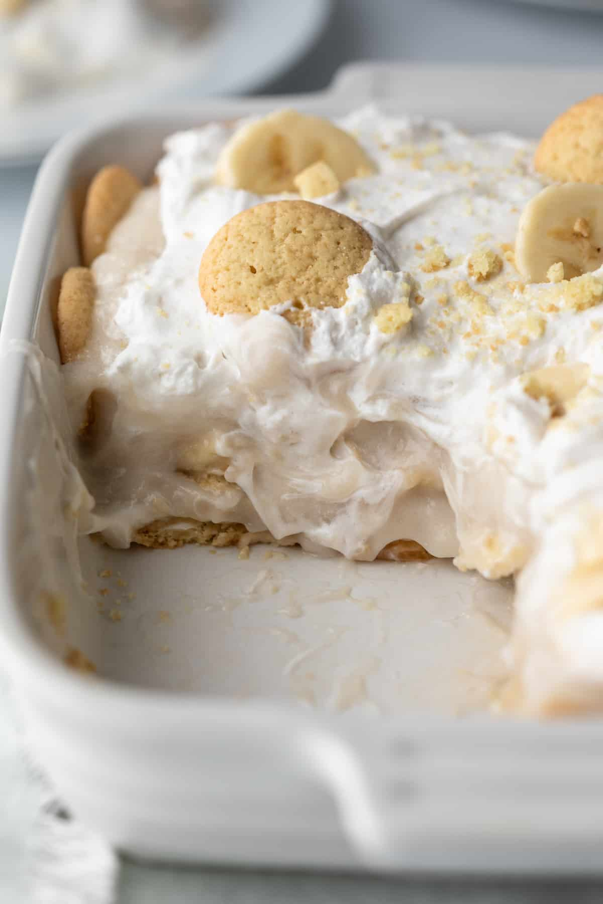 close up of inside showing creamy pudding, whipped topping, and vanilla wafers.