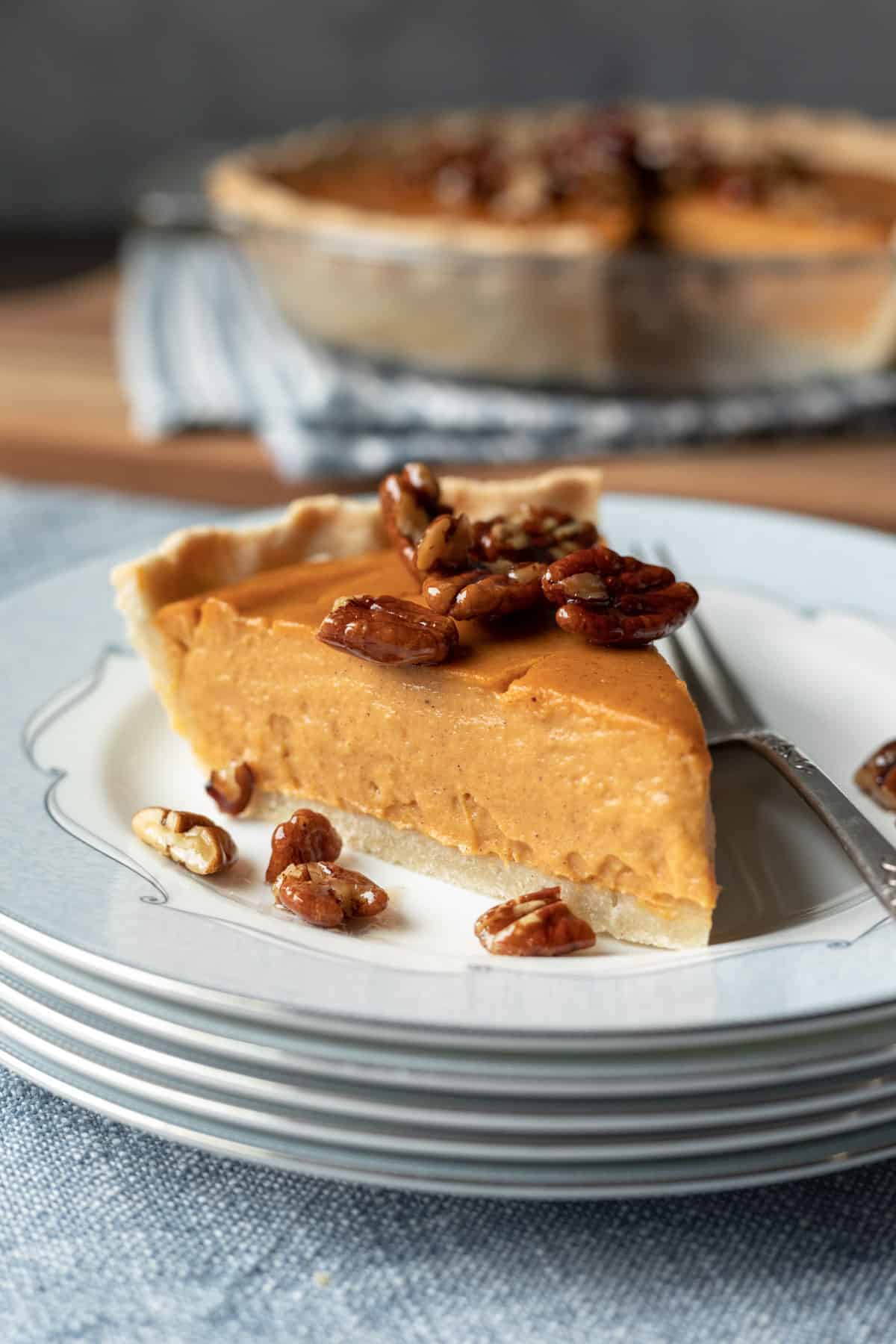 side view of a slice of pie showing creamy sweet potato filling.