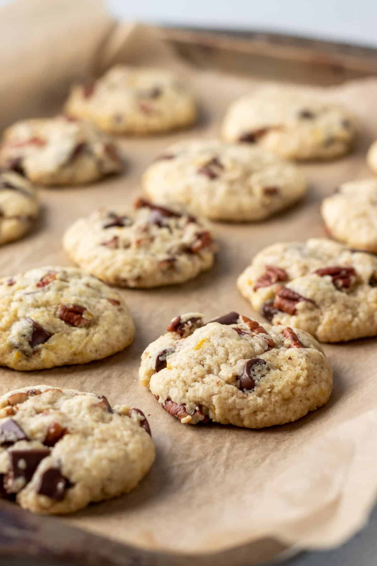 chocolate chunk cookies on a parchment-lined baking sheet.