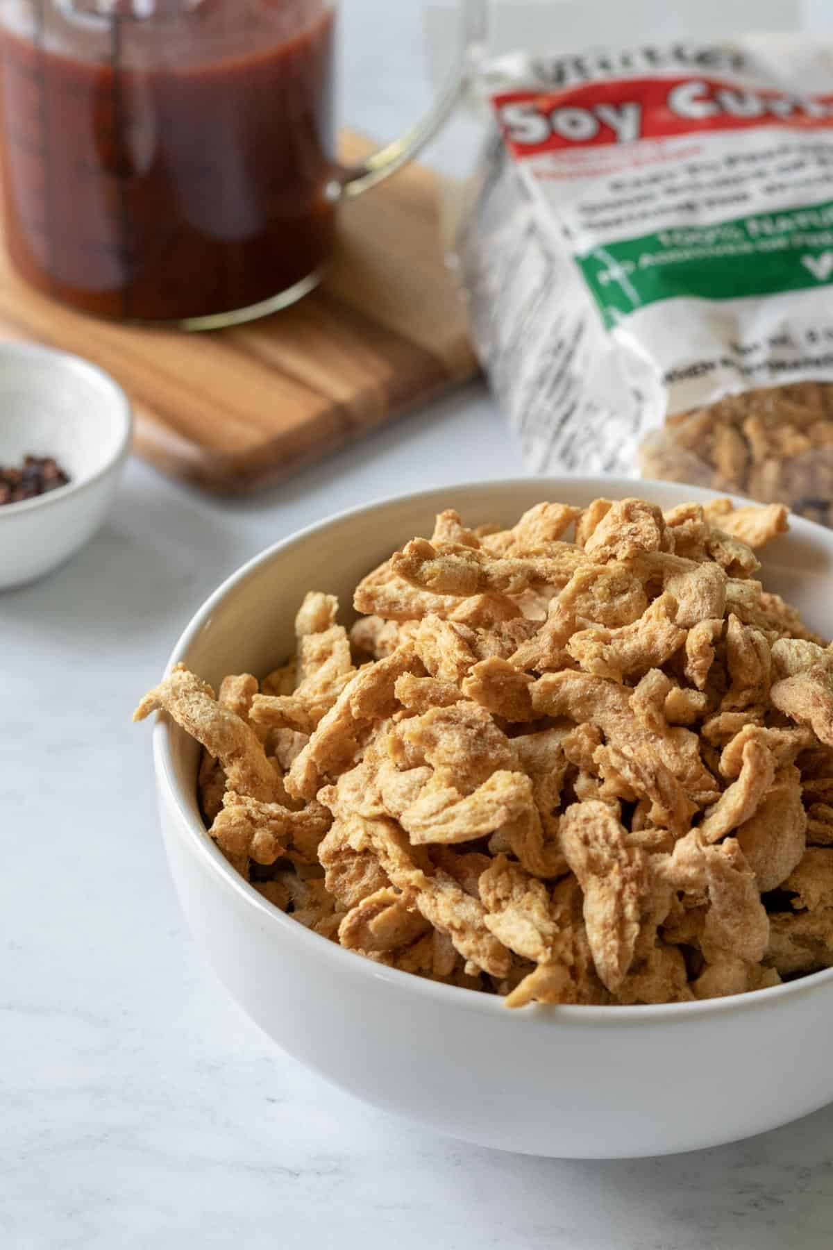 dry soy curls in a small white bowl.