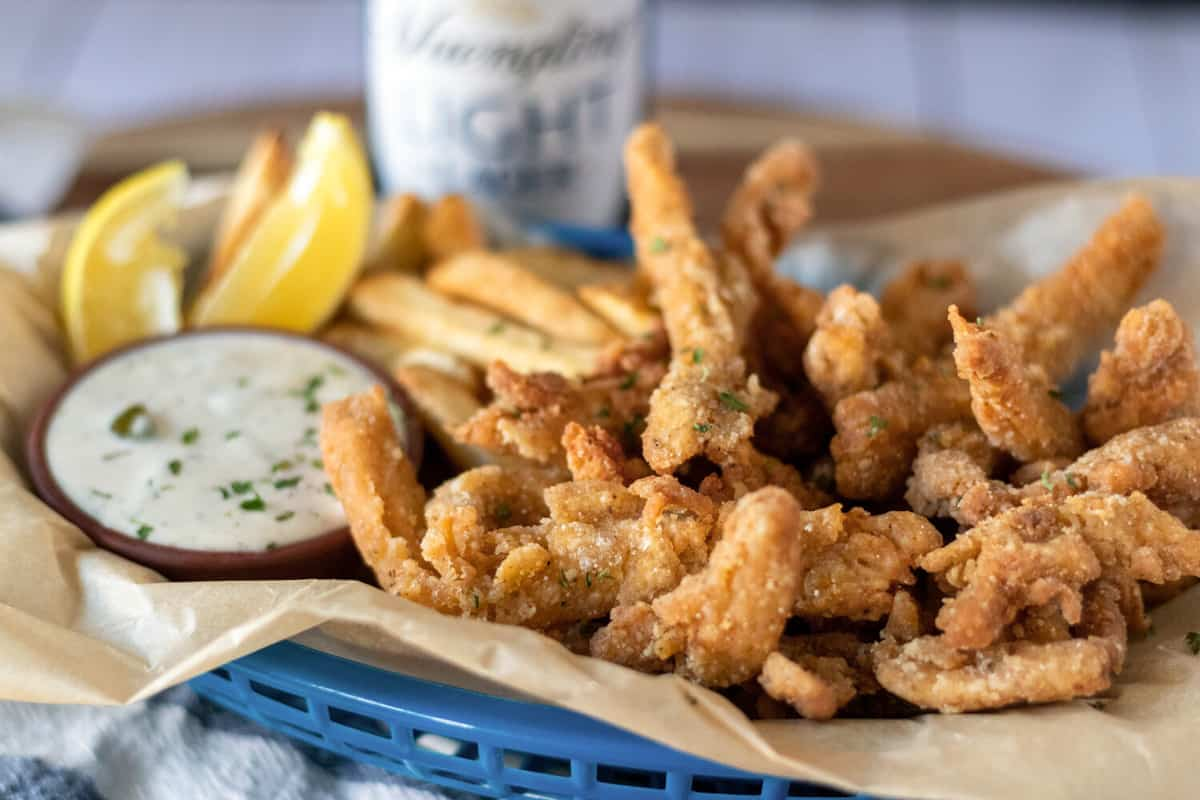 blue basket filled with vegan clam strips made from soy curls.