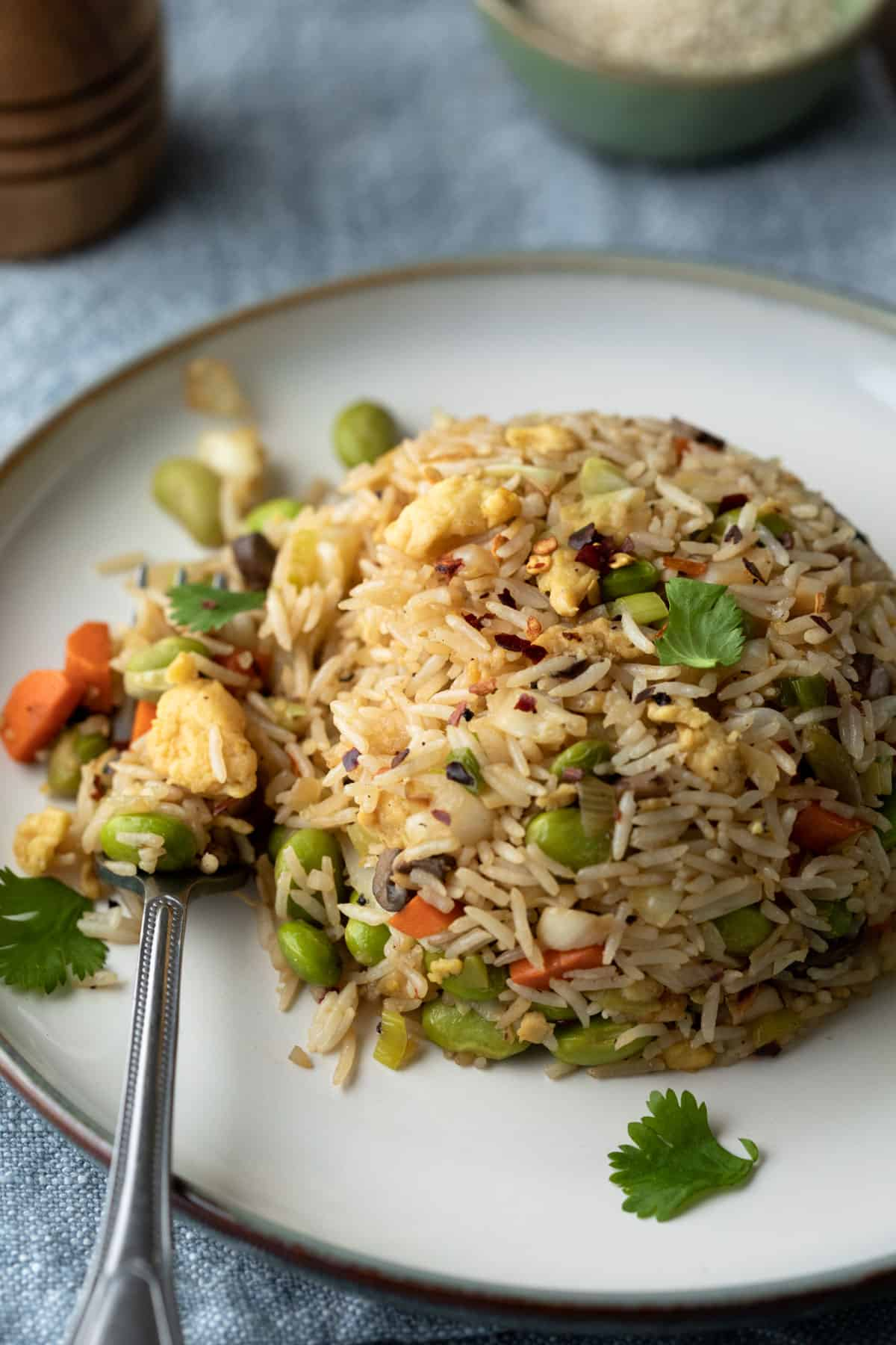 vegetable fried rice made with edamame and Just Egg on a plate.