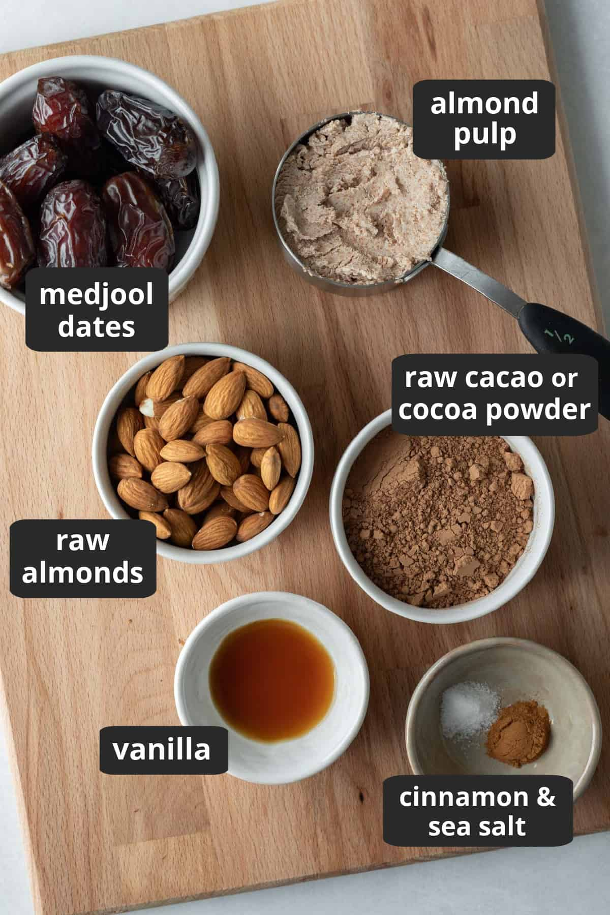 labeled photo of the 7 ingredients needed to make almond pulp energy bites.