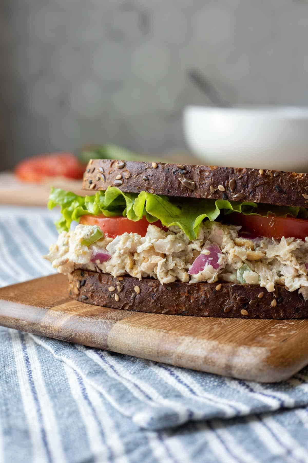 close up side view of a creamy vegan chicken salad sandwich.