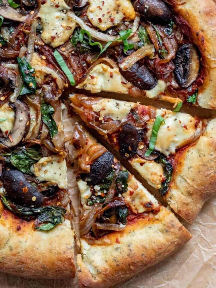overhead view of decadent looking pizza with melted cashew cheese on top.